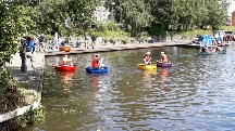 Coracles racing in canal at Welshpool