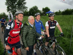 Sir Gareth Edwards and cyclists at the start of the Montgomery Canal Triathlon